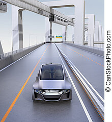 Front view of silver autonomous car driving on the highway...