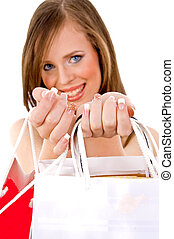front view of smiling female showing carry bags on an isolated white background