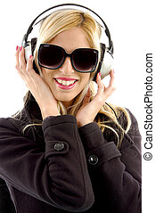front view of smiling woman listening music