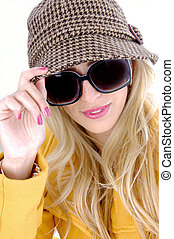 front view of stylish female in sunglasses against white...