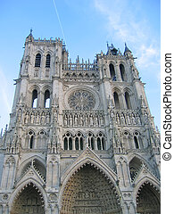 Front view of the cathedral with blue sky, Amiens, France - ...