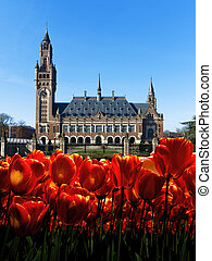 Front view of the Peace Palace ornamented with red and yellow tulips during Spring's time