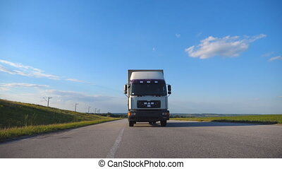 Front view of truck driving on a highway. Lorry rides...