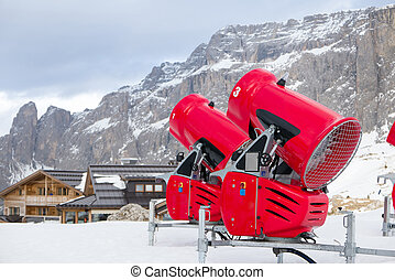 Front view of two snow cannons in alpine ski resort