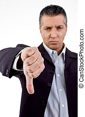 front view of unhappy boss showing thumb down with white...