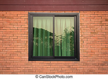 front view of window exterior on brick wall