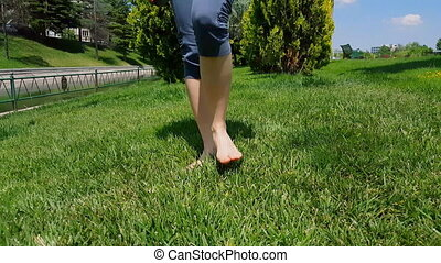 Front view of woman legs in blue tights walking slowly on ...