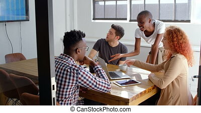 Front view of young mixed-race business team planning and...
