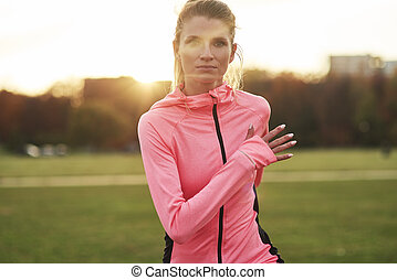 Front view of young woman jogging in the park