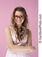 Front view of young woman with heart shaped glasses