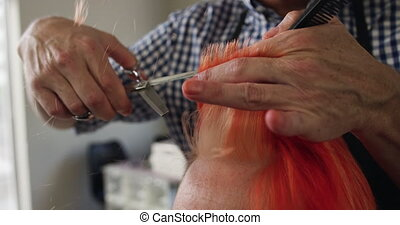 Front view woman having her hair styled by a hairdresser - ...