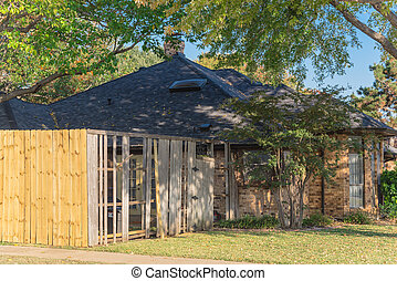 Front yard of corner house with wooden fence replacement in progress suburbs Dallas, Texas, USA
