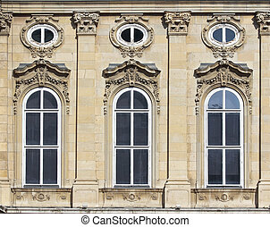 frontage - Three arched windows decorated mansion.