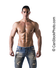 Frontal shot of shirtless muscular young man in jeans,...