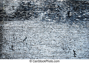 frontal view on a grey weathered old brick wall in berlin