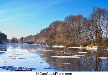 Frost on the trees on bank of river