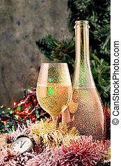 Frosted bottle and glass of champagne