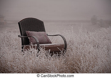 Frosted Chair - Peaceful empty chair in the winter frosted...
