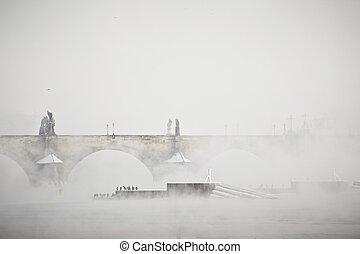 Frosty morning - Charles bridge in morning fog, Prague,...
