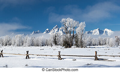 frosty ranch wooden fence jagged mountains