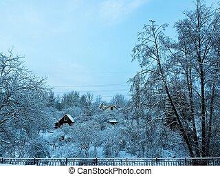 Frosty snowy winter morning in the Russian village