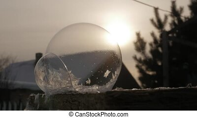 frosty soap bubble. Frozen Snow Globe. Snowflake Ice...