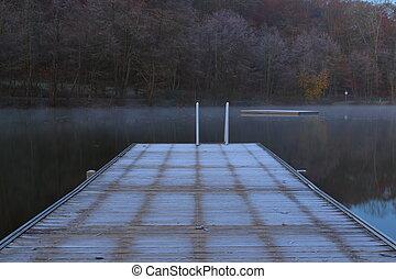 Dock on lake in winter morning.
