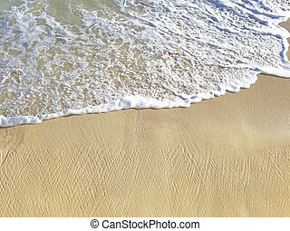 frothy saltwater on beach