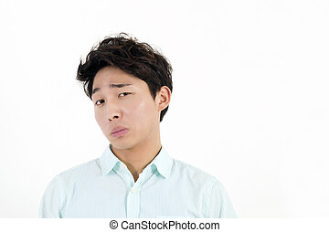 Frowning asian male student