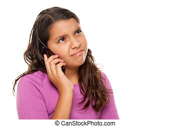 Frowning Hispanic Girl On Cell Phone Isolated on a White Background.