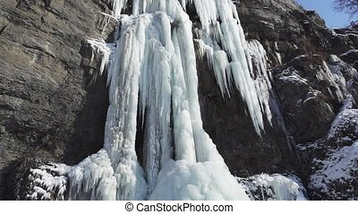 Frozen beautiful waterfall in winter. Ukraine