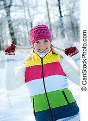 Frozen beautiful woman in winter clothing outdoors