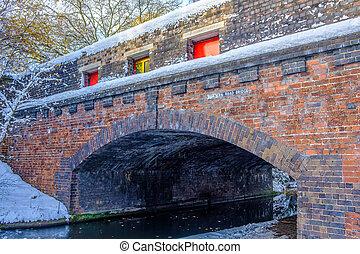Frozen Birmingham Canal and Brick Bridge - View of frozen...