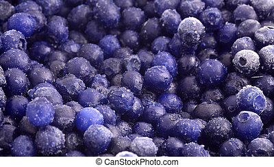 frozen blueberries - a pile of small frozen wild blueberries