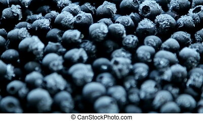 frozen blueberries with frost in the macro