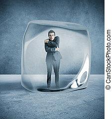 Frozen businessman blocked in the ice