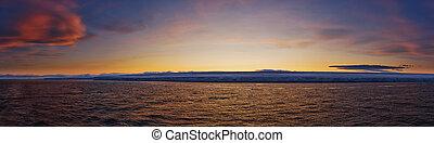 Frozen Coastline at Sunset
