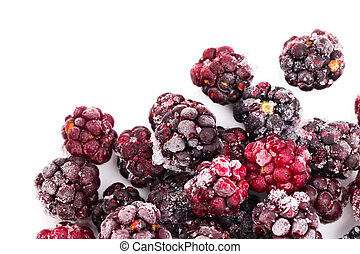 Frozen dewberries isolared on white background. Shallow depth of
