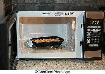Frozen Dinner - Frozen chicken noodle dinner in microwave in...