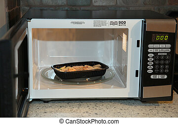 Frozen Dinner - Frozen chicken noodle dinner in microwave in...