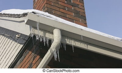 Frozen eavestrough. - Frozen eavestrough with dripping...