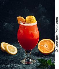 frozen fresh fruit juice with lemon in the glass