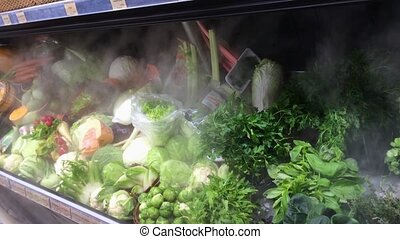 Frozen fridge with many vegetables in a shop