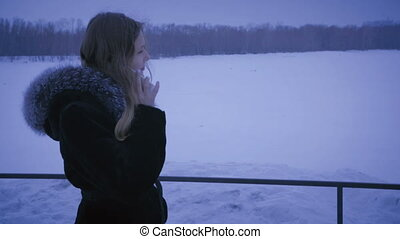 Frozen girl calling on smartphones. Guy is late for date.