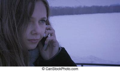 Frozen girl calling on smartphones.