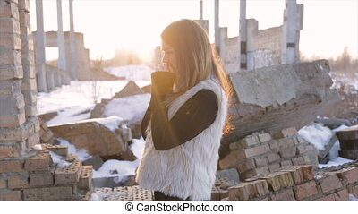 Frozen girl in an abandoned construction site.slow-motion