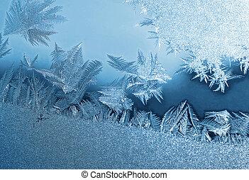 frozen glass - blue frosty natural pattern on window glass