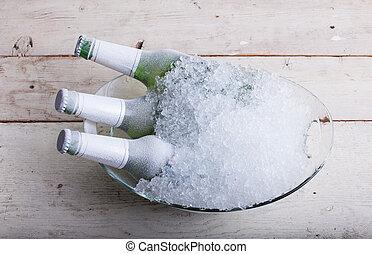 Frozen glass bottles of beer