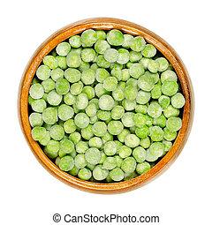 Frozen green peas, seeds of Pisum sativum in wooden bowl - ...