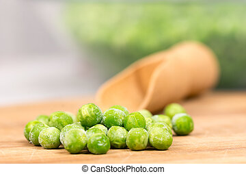 Frozen green peas with blurred background